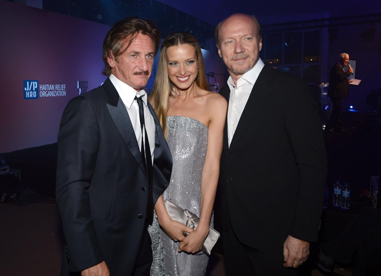 CANNES, FRANCE - MAY 18:  (L-R) Actor Sean Penn, model Petra Nemcova and director Paul Haggis attends the Haiti Carnival in Cannes Benefitting J/P HRO, Artists for Peace and Justice & Happy Hearts Fund Presented By Armani during the 65th Annual Cannes Film Festival on May 18, 2012 in Cannes, France.  (Photo by Michael Buckner/Getty Images)