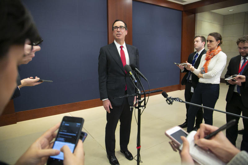 Treasury Secretary Steven Mnuchin speaks to reporters after giving a classified briefing to members of the House of Representatives, telling them that the Trump administration will keep strict U.S. sanctions on the Russian oligarch Oleg Deripaska, on Capitol Hill in Washington, Thursday, Jan. 10, 2019. (AP Photo/J. Scott Applewhite)