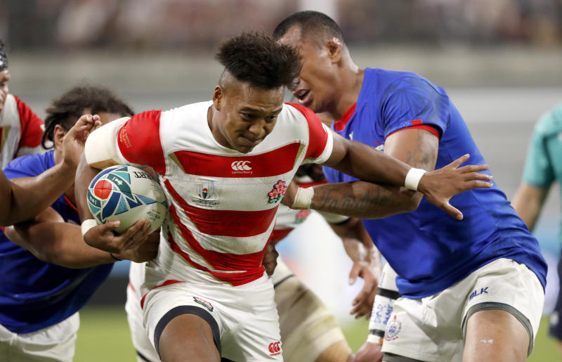 Japan's Kotaro Matsushima runs at that Samoan defense during the Rugby World Cup Pool A game at City of Toyota Stadium between Japan and Samoa in Tokyo City, Japan, Saturday, Oct. 5, 2019. (AP Photo/Shuji Kajiyama)