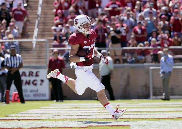 Stanford 's Christian McCaffrey runs in for a touchdown after a reception during the first half of an NCAA college football game against UC Davis on Saturday, Aug. 30, 2014, in Stanford, Calif. (AP Photo/Marcio Jose Sanchez)