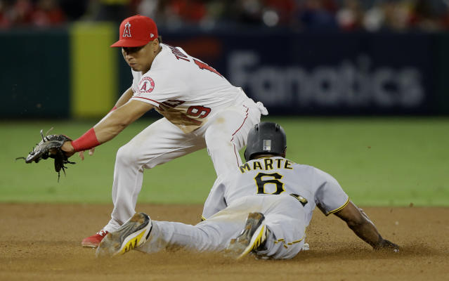 Pittsburgh Pirates' Starling Marte, right, steals second base as the late throw reaches Los Angeles Angels shortstop Wilfredo Tovar during the fourth inning of a baseball game in Anaheim, Calif., Monday, Aug. 12, 2019. (AP Photo/Alex Gallardo)