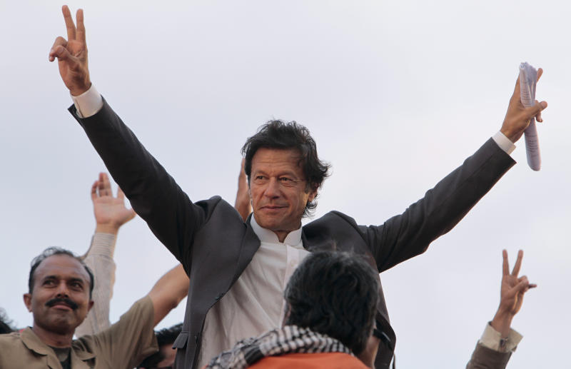 Pakistani cricket legend-turned politician Imran Khan waves to his supporters at a rally in Lahore, Pakistan on Saturday, March 23, 2013.  Khan rallied around 100,000 flag-waving supporters in the eastern city of Lahore on Saturday ahead of a historic national election later this spring. (AP Photo/K.M. Chaudary)