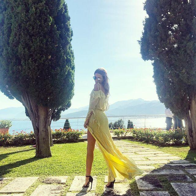 """<p>Ah Millie Mackintosh and her never-ending collection of wedding ready dresses. This yellow maxi was from her own fashion collection and suited the stunning scenery perfectly.</p><p><a href=""""https://www.instagram.com/p/BVKs52-gNRG/"""" rel=""""nofollow noopener"""" target=""""_blank"""" data-ylk=""""slk:See the original post on Instagram"""" class=""""link rapid-noclick-resp"""">See the original post on Instagram</a></p>"""