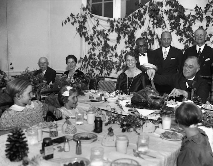 President Franklin D. Roosevelt carves the turkey during the annual Thanksgiving dinner in 1933 for polio patients at Warm Springs, Georgia, with first lady Eleanor Roosevelt smiling beside him. Roosevelt was among the most famous Americans to get polio, and he helped start what eventually would become the March of Dimes. That organization raised money for a vaccine, which was found in 1955 by Jonas Salk.