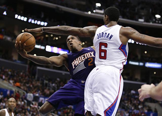 Phoenix Suns' Eric Bledsoe, left, puts up a shot as he is defended by Los Angeles Clippers' DeAndre Jordan during the second half of an NBA basketball game on Monday, Dec. 30, 2013, in Los Angeles. (AP Photo/Jae C. Hong)