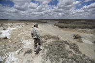 Biologist Jude Smith looks over a nearly dry spring at the Muleshoe National Wildlife Refuge outside Muleshoe, Texas, on Tuesday, May 18, 2021. The spring is fed by the Ogallala Aquifer, which is becoming depleted because of irrigation and drought. (AP Photo/Mark Rogers)