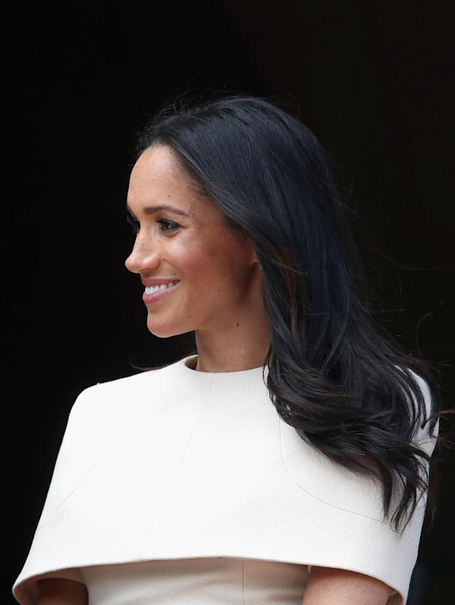 <p>For the Duchess of Sussex's debut engagement with the queen on June 14, she opted for subtle waves and let her Givenchy dress steal the spotlight. (Photo: Getty Images) </p>