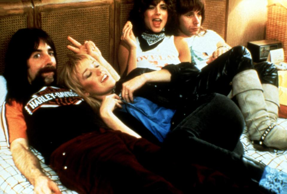Derek (Harry Shearer) and Nigel (Christopher Guest) with Spinal Tap groupies in 'This is Spinal Tap' (Photo: Embassy Pictures/Courtesy Everett Collection)