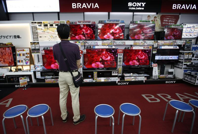 A shopper looks at Sony Corp's Bravia television monitors at an electronics store in Tokyo