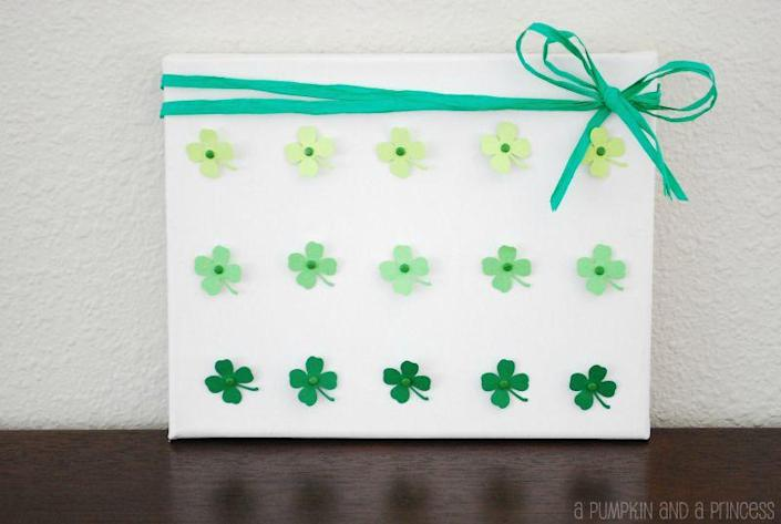 """<p>Add the trendy ombré look to your St. Patrick's décor with this easy tutorial. You can even reuse the canvas for other holiday decorations. </p><p><strong>Get the tutorial at <a href=""""https://apumpkinandaprincess.com/ombre-four-leaf-clover-craft/"""" rel=""""nofollow noopener"""" target=""""_blank"""" data-ylk=""""slk:A Pumpkin and a Princess"""" class=""""link rapid-noclick-resp"""">A Pumpkin and a Princess</a>.</strong></p><p><a class=""""link rapid-noclick-resp"""" href=""""https://go.redirectingat.com?id=74968X1596630&url=https%3A%2F%2Fwww.walmart.com%2Fsearch%2F%3Fquery%3Dglue%2Bdots&sref=https%3A%2F%2Fwww.thepioneerwoman.com%2Fhome-lifestyle%2Fcrafts-diy%2Fg34931626%2Fst-patricks-day-decorations%2F"""" rel=""""nofollow noopener"""" target=""""_blank"""" data-ylk=""""slk:SHOP GLUE DOTS"""">SHOP GLUE DOTS</a><br></p>"""