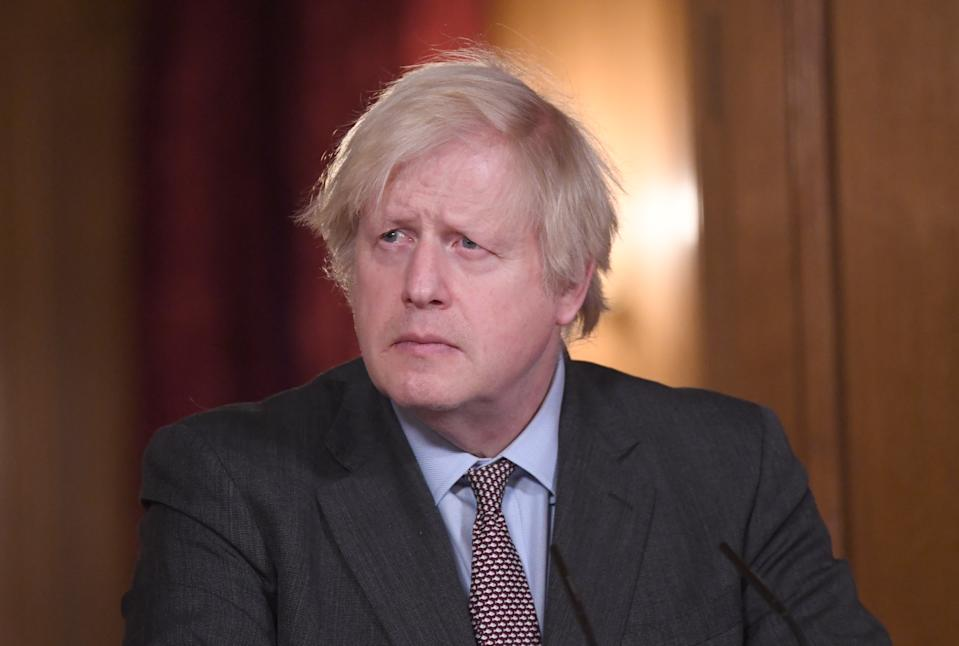 LONDON, ENGLAND - FEBRUARY 03:  Prime Minister Boris Johnson takes part in a media briefing in Downing Street on February 3, 2021 in London, England. The UK has now administered in excess of 10 million vaccinations. Daily new cases of Covid-19 were 19,202, down week on week by 25.1%  and 1,322 further deaths, down from 1,449 yesterday. (Photo by Stefan Rousseau-WPA Pool/Getty Images)