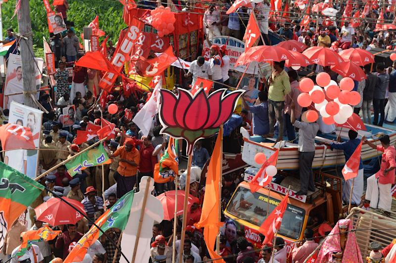 Supporters of BJP, Congress and CPI celebrate in front of each other during the final day of election campaigning in Pathanamthitta, Kerala. (Photo: ARUN SANKAR via Getty Images)