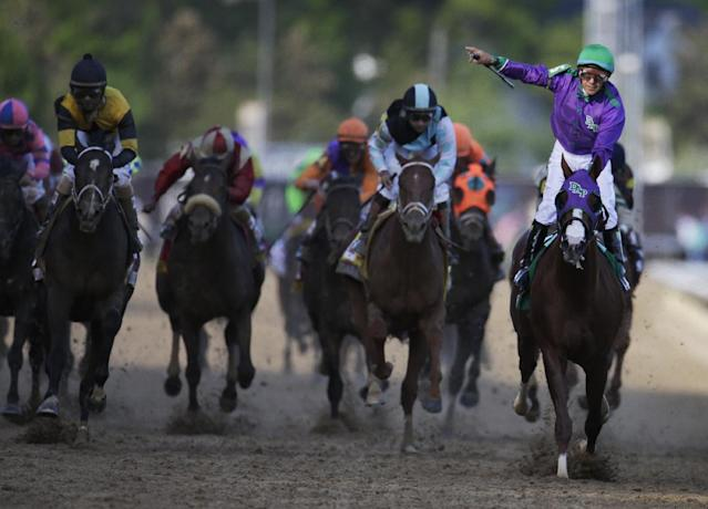Victor Espinoza rides California Chrome, right, to victory during the 140th running of the Kentucky Derby horse race at Churchill Downs Saturday, May 3, 2014, in Louisville, Ky. (AP Photo/Darron Cummings)