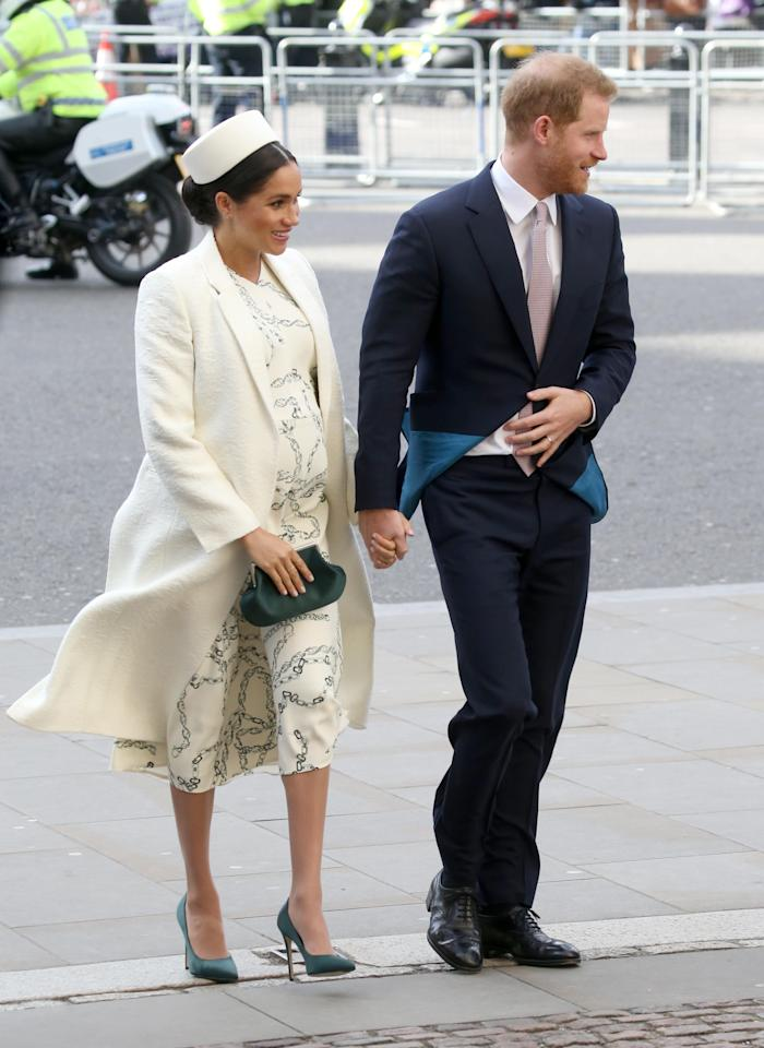 <p>For the Commonwealth Day service, Meghan wore a cream chain print dress and coat by Victoria Beckham, with emerald green satin shoes and clutch, also by the British fashion designer <em>[Photo: Getty]</em> </p>