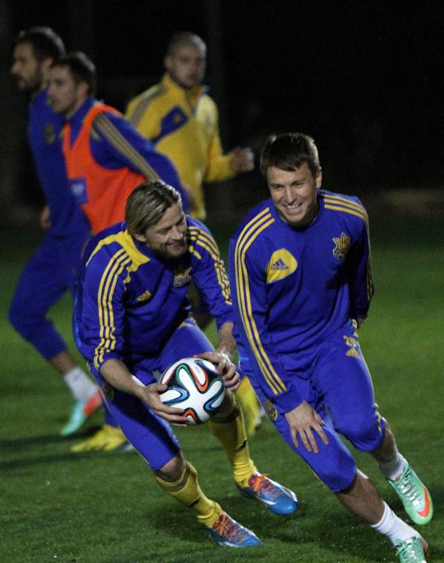 Ukraine's Anatoliy Tymoschuk, left, and Ruslan Rotan attend a training session in Ayia Napa resort on the southeast of Cyprus, Tuesday March 4, 2014. The Ukrainians will play the United States in a friendly match on Wednesday in Cyprus, after the match was moved from Kharkiv in Ukraine to Larnaca in Cyprus for security reasons. (AP Photo/Petros Karadjias)
