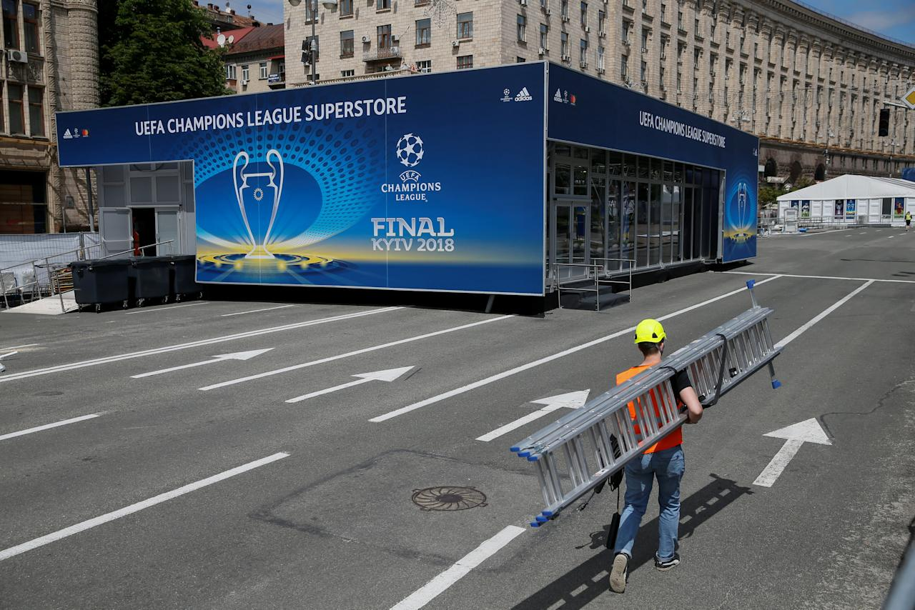 An employee walks in the compound of the official fan zone for the UEFA Champions League final in central Kiev, Ukraine May 21, 2018. REUTERS/Valentyn Ogirenko