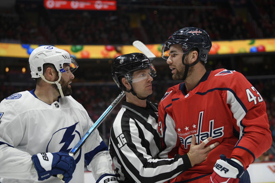 Washington Capitals right wing Tom Wilson (43) and Tampa Bay Lightning left wing Pat Maroon, left, are separated by an official during the second period of an NHL hockey game, Saturday, Dec. 21, 2019, in Washington. (AP Photo/Nick Wass)