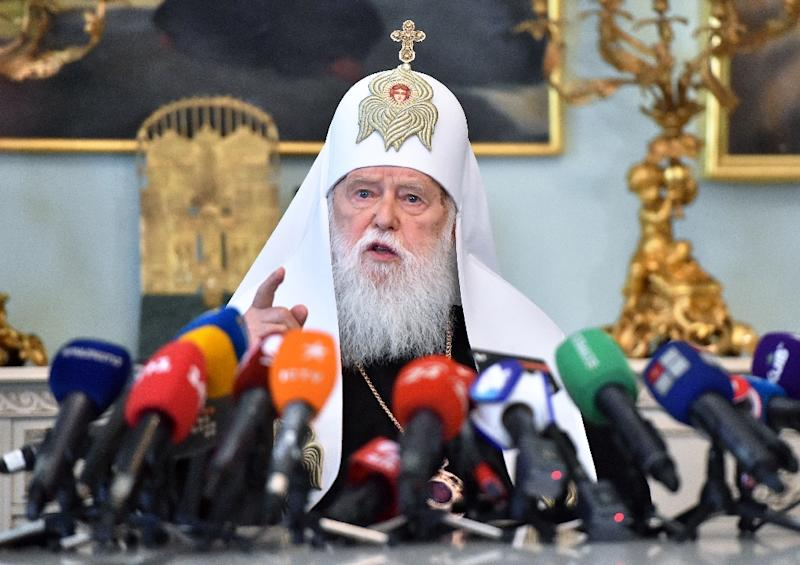 Honorary Patriarch Filaret, 90, accused the young head of the newly created united church of reneging on an agreement to share power (AFP Photo/Sergei SUPINSKY)