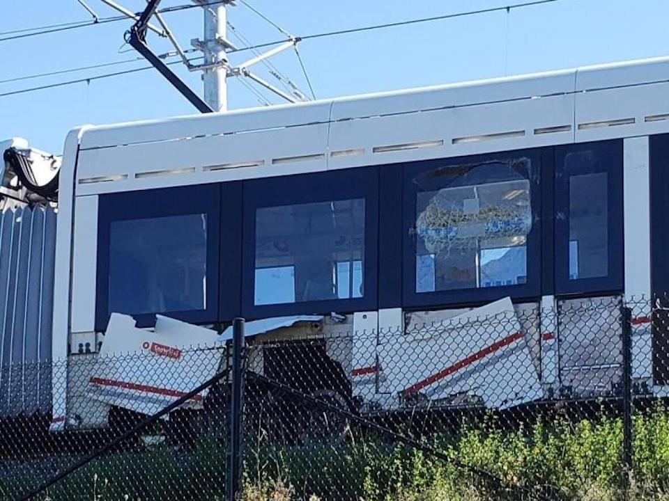 The Transportation Safety Board (TSB) of Canada says this part of the Ottawa light rail train derailed on Sept. 19. A photo released Oct. 7 appears to show damage to the side of the train. (Transportation Safety Board of Canada - image credit)