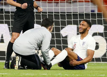 England's Joe Gomez receives medical attention. Reuters/John Sibley