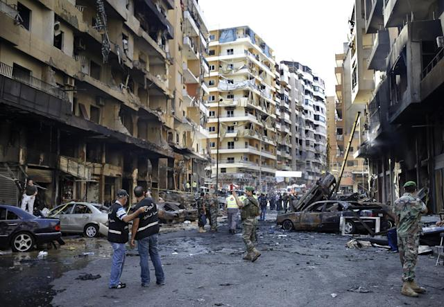 Lebanese Army investigators inspect at the site of a car bomb explosion in an overwhelmingly Shiite area and stronghold of the Lebanese militant group Hezbollah, in the southern suburb of Beirut, Lebanon, Friday, Aug. 16, 2013. A powerful car bomb tore through a bustling south Beirut neighborhood that is a stronghold of Hezbollah on Thursday, killing tens of people and trapping dozens of others in an inferno of burning cars and buildings in the bloodiest attack yet on Lebanese civilians linked to Syria's civil war. (AP Photo/Hussein Malla)