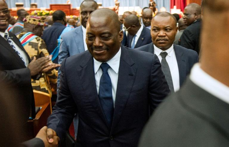 Congolese President Joseph Kabila (C) refused to stand aside at the end of his term late 2016