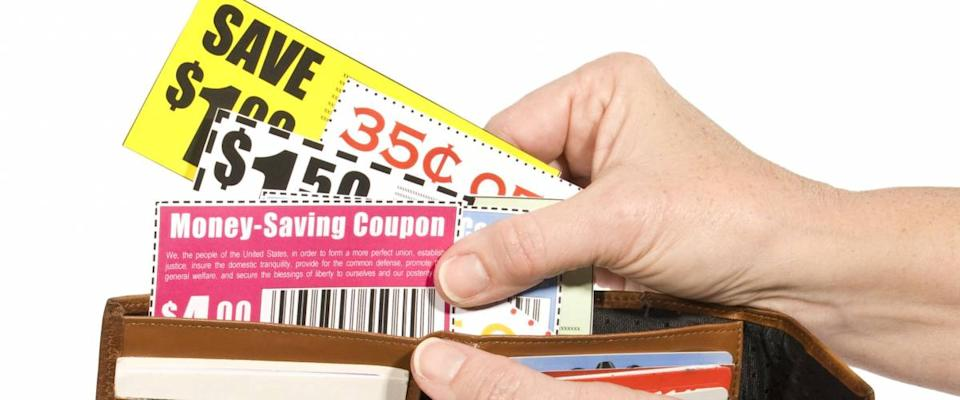 Thrifty Shopper Using Coupons Isolated On White
