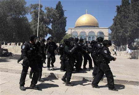 Israeli policemen react during clashes with Palestinians on the compound known to Muslims as the Noble Sanctuary and to Jews as the Temple Mount in Jerusalem's Old City September 6, 2013. REUTERS/Ammar Awad