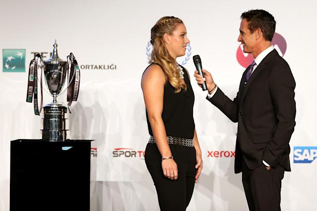 ISTANBUL, TURKEY - OCTOBER 20: Angelique Kerber of Germany is interviewed by Master of Ceremonies Andrew Krasny during the draw ceremony for the WTA Championships at the Renaissance Polat Hotel on October 20, 2013 in Istanbul, Turkey. (Photo by Matthew Stockman/Getty Images)