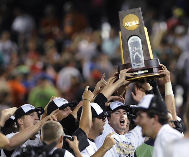 Vanderbilt players celebrate after Vanderbilt defeated Virginia 3-2 in Game 3 of the best-of-three NCAA baseball College World Series finals in Omaha, Neb., Wednesday, June 25, 2014. (AP Photo/Eric Francis)