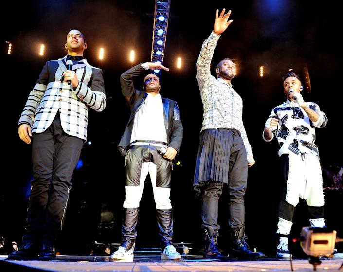 MANCHESTER, ENGLAND - DECEMBER 14:  Marvin Humes, JB Gill, Oritse Williams and Aston Merrygold of JLS perform on stage at Phones 4U Arena as part of the final tour on December 14, 2013 in Manchester, England.  (Photo by Shirlaine Forrest/WireImage)