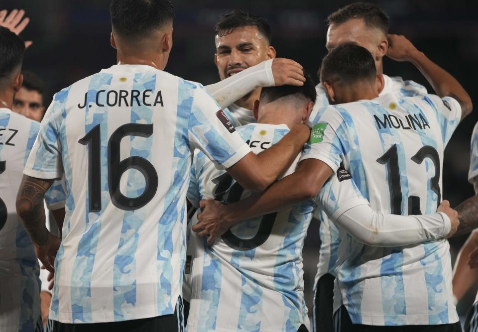 Argentina's Lionel Messi, center, celebrates with his teammates after scoring his third goal against Bolivia during a qualifying soccer match for the FIFA World Cup Qatar 2022, in Buenos Aires, Argentina, Thursday, Sept. 9, 2021. (AP Photo/Natacha Pisarenko, Pool)