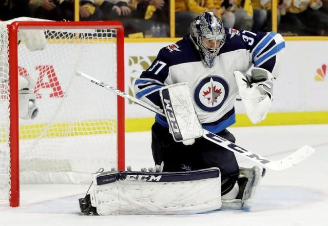 Jets sign star goaltender Hellebuyck to six-year contract worth $37 million