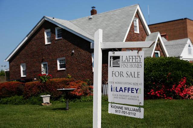 A 'for sale' is seen outside a single family house in Uniondale, New York. U.S. REUTERS/Shannon Stapleton