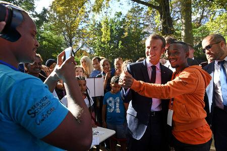 FILE PHOTO: French President Emmanuel Macron poses for a selfie as visitors are allowed access to the Elysee Palace in Paris, France, September 15, 2018, as part of France's Heritage Days. Picture taken September 15, 2018.  Anne-Christine Poujoulat/Pool via REUTERS/File Photo