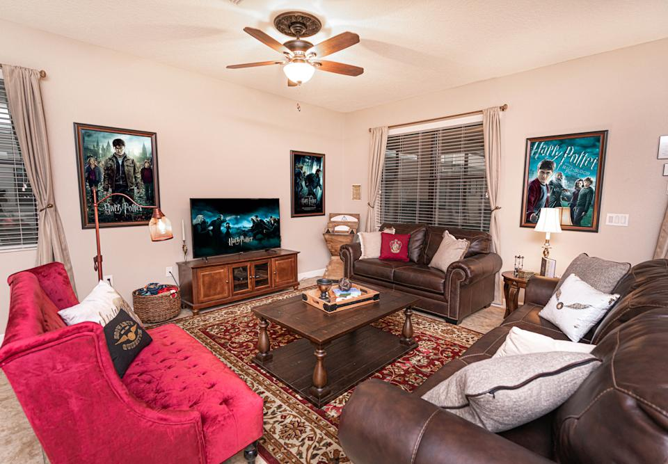 PIC BY @LOMA HOMES / CATERS NEWS AGENCY (PICTURED- The sitting area cinema room for watching Harry Potter movies ) - Harry Potter fans looking for a first post-lockdown trip can put this place at the top of their list - a night in a Hogwarts- themed Airbnb. The eight-bedroom home, called ' Wizard's Way' is based in Florida, US, near the Universal Orlando Resort. There are rooms based on the four houses Gryffindor, Hufflepuff, Ravenclaw, and Slytherin and each bathroom has its own Harry Potter theme, from Hedwig and the  Ministry of Magic to Dobby, and Sirius Black. One of the bedrooms  features an interactive car-shaped bed which is inspired by the scene where Harry and Ron get stuck in the Willow Tree of the second part of the film series. - SEE CATERS COPY