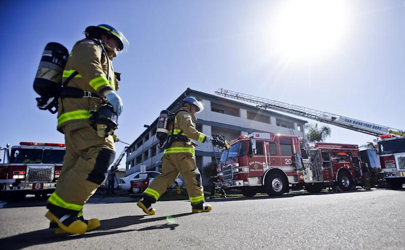 Firefighters respond to the Heritage Hotel after an explosion on Wednesday, Jan. 30, 2013, in San Diego. The cause of the explosion is under investigation. Three people were injured in the explosion at the hotel near SeaWorld San Diego and investigators were trying to determine whether there was a drug lab inside, authorities said. Three people were taken to a hospital to be treated for burns and one was in serious condition, said San Diego Fire-Rescue Department spokesman Maurice Luque. (AP Photo/Lenny Ignelzi)