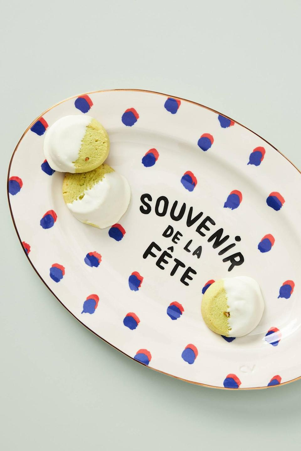 "<p>This <a href=""https://www.popsugar.com/buy/Clare-V-Anthropologie-Souvenir-de-la-Fete-Platter-562169?p_name=Clare%20V.%20for%20Anthropologie%20Souvenir%20de%20la%20Fete%20Platter&retailer=anthropologie.com&pid=562169&price=58&evar1=casa%3Aus&evar9=47360872&evar98=https%3A%2F%2Fwww.popsugar.com%2Fhome%2Fphoto-gallery%2F47360872%2Fimage%2F47361107%2FClare-V-for-Anthropologie-Souvenir-de-la-Fete-Platter&list1=shopping%2Chome%20decor%2Cdecor%20shopping%2Chome%20shopping&prop13=api&pdata=1"" rel=""nofollow noopener"" class=""link rapid-noclick-resp"" target=""_blank"" data-ylk=""slk:Clare V. for Anthropologie Souvenir de la Fete Platter"">Clare V. for Anthropologie Souvenir de la Fete Platter</a> ($58) is a cute addition to your kitchen.</p>"