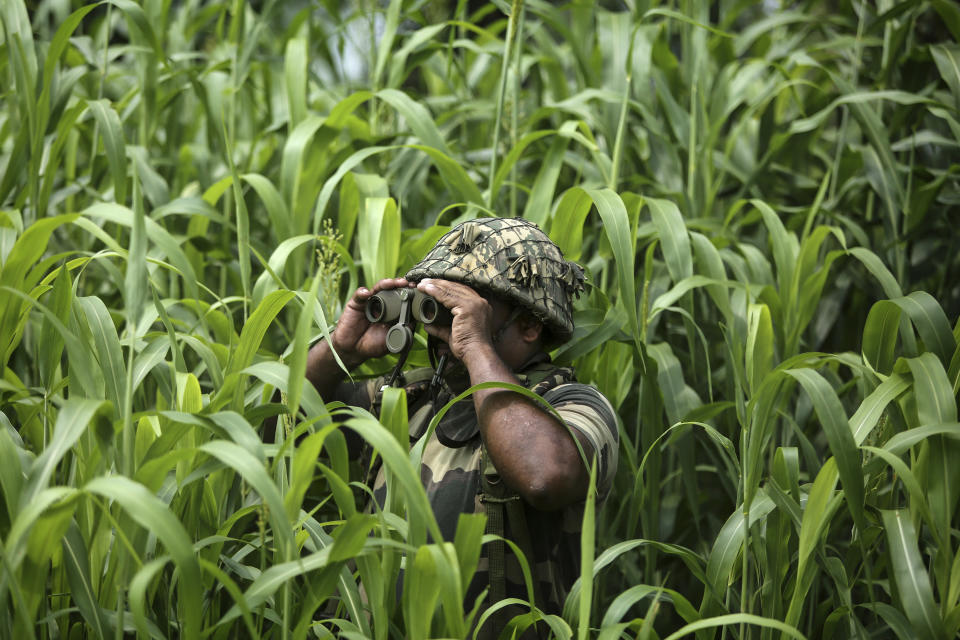 An Indian Border Security Force (BSF) soldier keeps vigil near the India Pakistan border at Garkhal in Akhnoor, about 35 kilometers (22 miles) west of Jammu, India, Aug. 13, 2019. The image was part of a series of photographs by Associated Press photographers which won the 2020 Pulitzer Prize for Feature Photography. (AP Photo/Channi Anand)