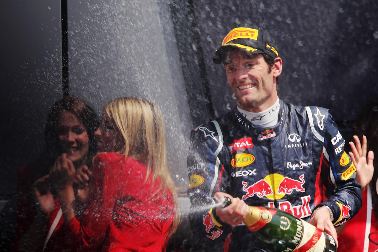 NORTHAMPTON, ENGLAND - JULY 08:  Mark Webber of Australia and Red Bull Racing celebrates on the podium after winning the British Grand Prix at Silverstone Circuit on July 8, 2012 in Northampton, England.  (Photo by Mark Thompson/Getty Images)