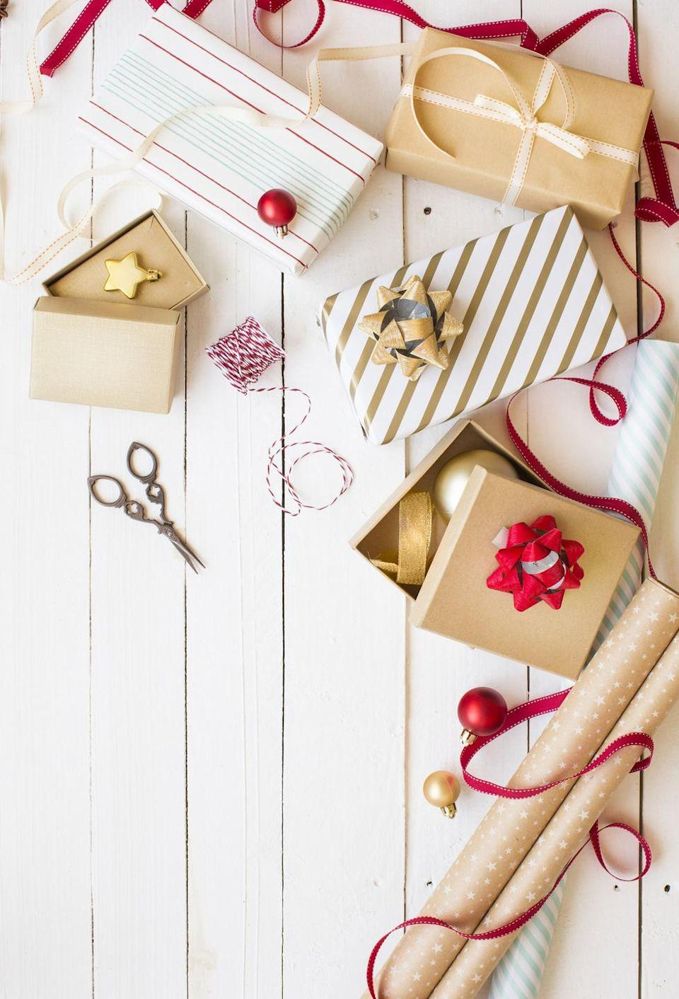 """<p>Don't wait until the last minute to <a href=""""https://www.oprahmag.com/life/g34015639/gift-wrapping-ideas/"""" rel=""""nofollow noopener"""" target=""""_blank"""" data-ylk=""""slk:wrap all those gifts"""" class=""""link rapid-noclick-resp"""">wrap all those gifts</a> under the tree. If you tackle the task early, it's actually a pretty fun Christmas activity—especially if you turn on a Hallmark movie and add a glass of wine to the mix. </p><p><a class=""""link rapid-noclick-resp"""" href=""""https://www.amazon.com/Hallmark-Black-Christmas-Wrapping-Reverse/dp/B088SQDN6F?tag=syn-yahoo-20&ascsubtag=%5Bartid%7C10072.g.34454588%5Bsrc%7Cyahoo-us"""" rel=""""nofollow noopener"""" target=""""_blank"""" data-ylk=""""slk:SHOP WRAPPING PAPER"""">SHOP WRAPPING PAPER</a></p>"""