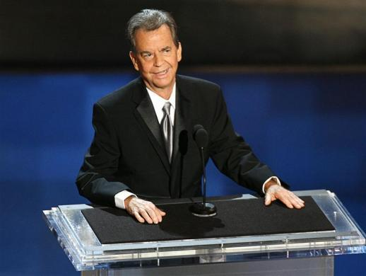 Dick Clark stands onstage during a tribute to him at the 58th annual Primetime Emmy Awards in Los Angeles