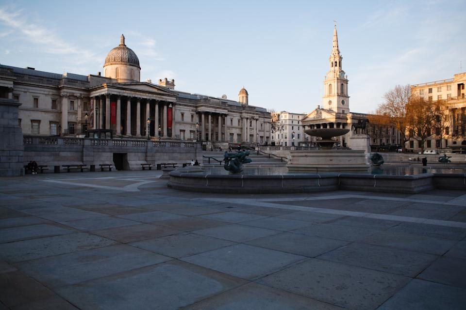 The National Gallery overlooks a near-deserted Trafalgar Square in London, England, on March 26, 2020. According to the latest daily figures a total of 578 people have so far died across the UK after testing positive for the covid-19 coronavirus. Hospitals in London, where around a third of cases have been diagnosed, are under particular strain. One senior hospital figure, Chris Hopson of the group NHS Providers, warned today of a 'tsunami' of cases to hit hospitals in the capital over the coming weeks. (Photo by David Cliff/NurPhoto via Getty Images)