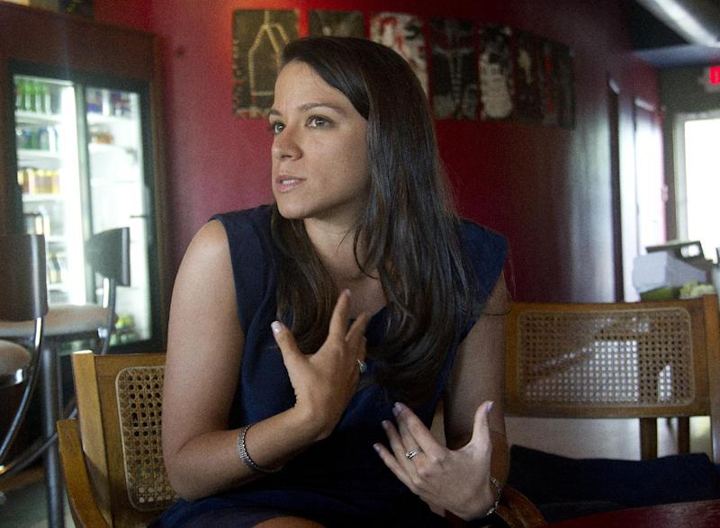 In this Friday, March 17, 2012 photo, Natalia Martinez discusses her family's decision to leave Cuba two decades ago, during an interview in Miami. Martinez will return to her homeland for the first time this week during Pope Benedict XVI's historic visit. She is among more than 300 Cuban-Americans who will form a delegation to Cuba led by Miami's Roman Catholic Archbishop Thomas Wenski. (AP Photo/J Pat Carter)