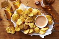 """<p><strong>Recipe:</strong> <a href=""""https://www.southernliving.com/recipes/fried-pickle-chips-recipe"""" rel=""""nofollow noopener"""" target=""""_blank"""" data-ylk=""""slk:Fried Pickle Chips"""" class=""""link rapid-noclick-resp"""">Fried Pickle Chips</a></p> <p>You won't need any relish to top your hot dog when you add these Fried Pickle Chips as a side. Crispy and tangy, they'll pair well with any hot dog topping combination.</p>"""