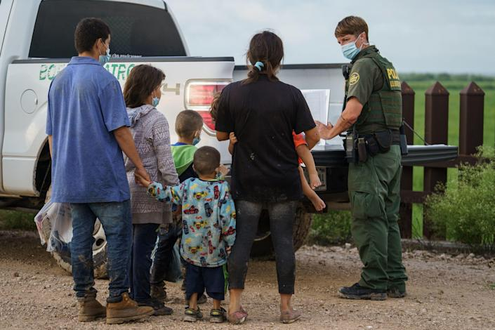 Migrants are processed by the U.S. Border Patrol after crossing the U.S.-Mexico border into the United States in Penitas, Texas, on July 8, 2021. / Credit: PAUL RATJE/AFP via Getty Images