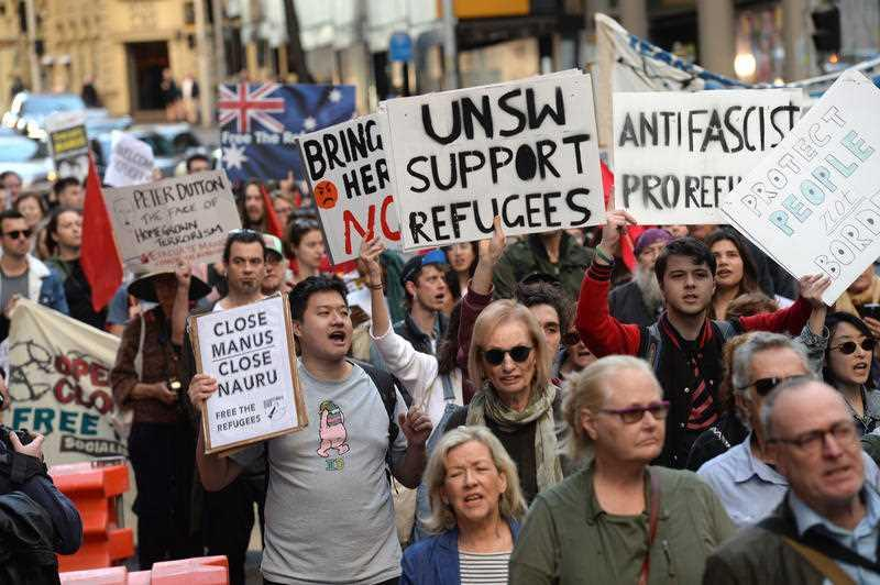 Protesters march through the central business district in Sydney calling for an end to offshore detention centres.