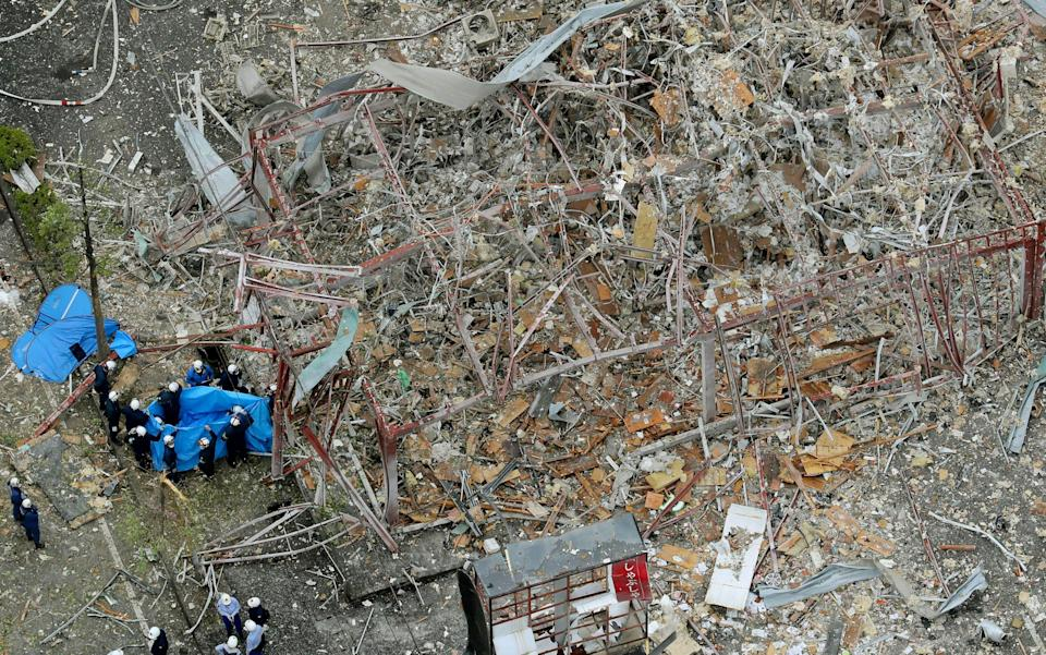 Investigators work at the site of an explosion in Koriyama, Fukushima prefecture, northern Japan - Kyodo News