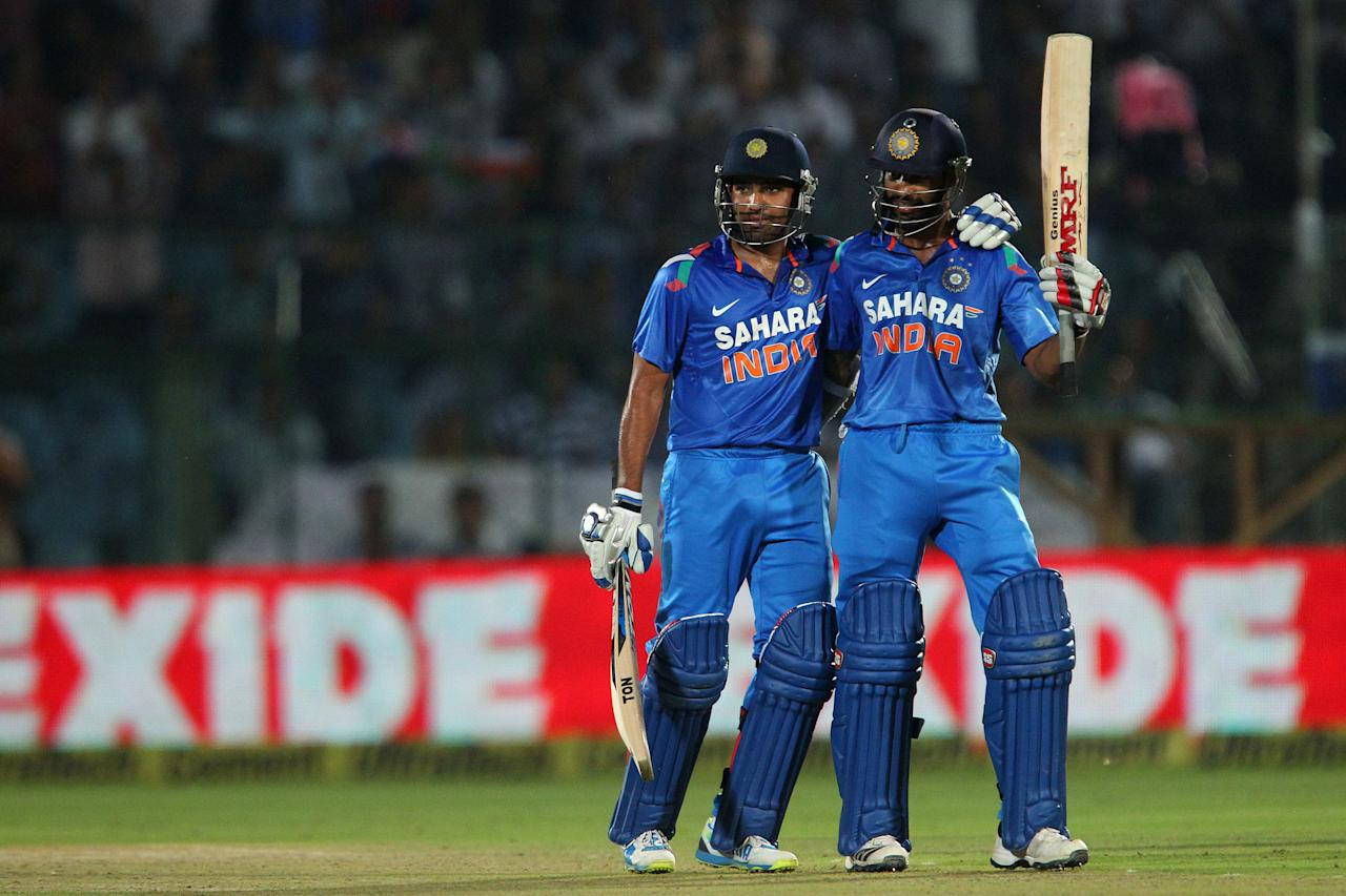 Rohit Sharma of India congratulates  Shikhar Dhawan of India on his fifty during the 2nd One Day International (ODI) match in the Star Sports Series between India and Australia held at the Sawai Mansingh Stadium in Jaipur on the 16th October 2013