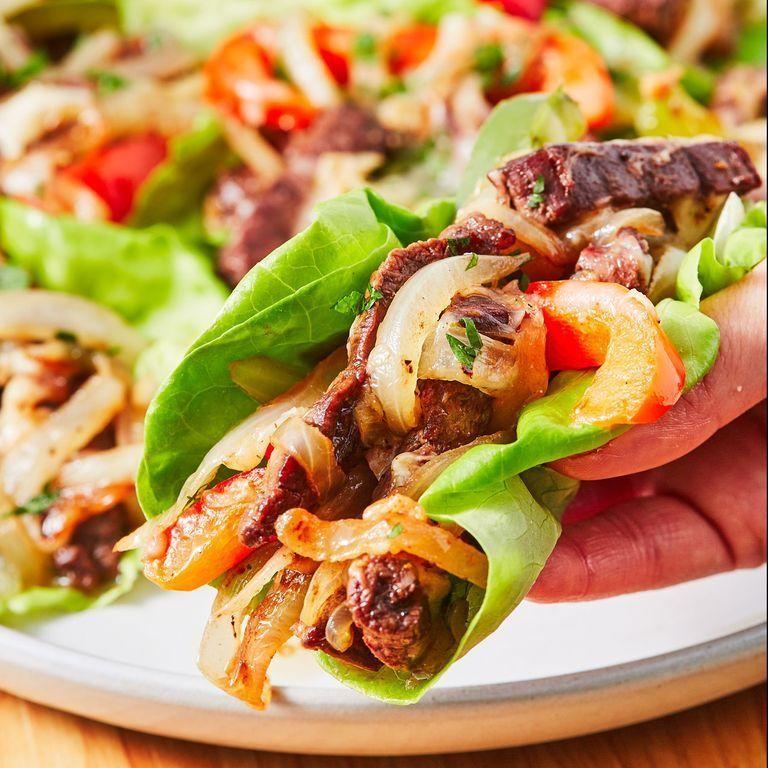 "<p>You will love these low carb Philly Cheesesteak lettuce wraps. And before you get all riled up, no, they're not in any way authentic. We'll be the first to admit it! </p><p>Get the <a href=""https://www.delish.com/uk/cooking/recipes/a32090138/no-carb-philly-cheesesteaks/"" rel=""nofollow noopener"" target=""_blank"" data-ylk=""slk:Philly Cheesesteak Lettuce Wraps"" class=""link rapid-noclick-resp"">Philly Cheesesteak Lettuce Wraps</a> recipe.</p>"